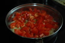 add tomatoes to onion